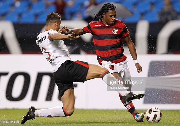 Diego Mauricio of Flamengo struggles for the ball with Gustavo of Atletico PR during a match as part of Copa Bridgestone Sudamericana 2011 at...