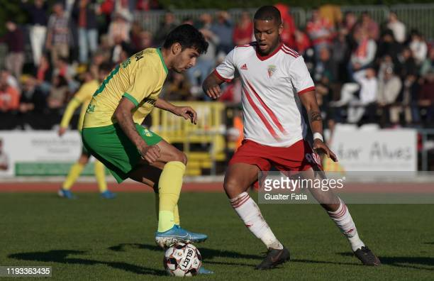 Diego Medeiros of CD Mafra with Ulisses Oliveira of UD Vilafranquense in action during the Liga Pro match between CD Mafra and UD Vilafranquense at...