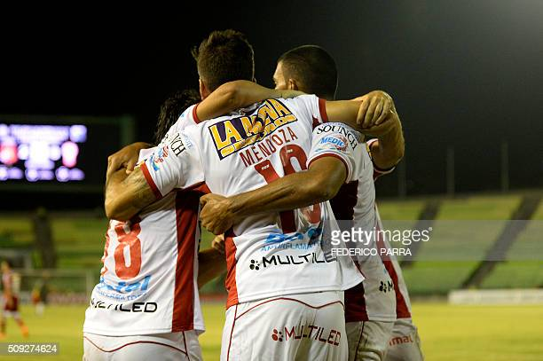 Diego Mendoza of Argentina's Huracan celebrates with teammates after scoring against Venezuela's Caracas FC during their Copa Libertadores 2016...