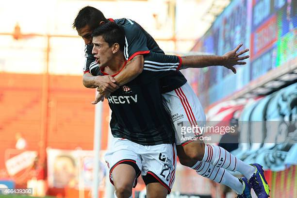 Diego Mendoza of Estudiantes celebrates with his teammate Carlos Auzqui after scoring the first goal of his team from the penalty spot during a match...