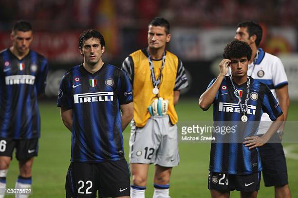 Diego Milito and Coutinho and Inter Milan teammates stand dejected after their team's 02 defeat at the end of the UEFA Super Cup match between Inter...