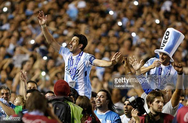 Diego Milito and Ivan Pillud of Racing Club celebrate the championship after winning a match between Racing Club and Godoy Cruz as part of 19th round...