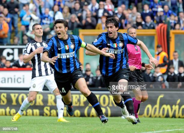 Diego Milito and Javier Zanetti of FC Internazionale Milano celebrate after the first goal during the Serie A match between AC Siena and FC...
