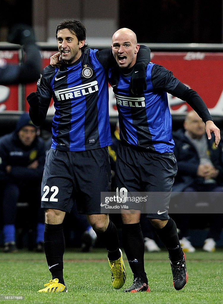 Diego Milito of FC Inter #22 celebrates with team-mate Esteban Cambiasso after scoring their third goal during the Serie A match between FC Internazionale Milano and AC Chievo Verona at San Siro Stadium on February 10, 2013 in Milan, Italy.