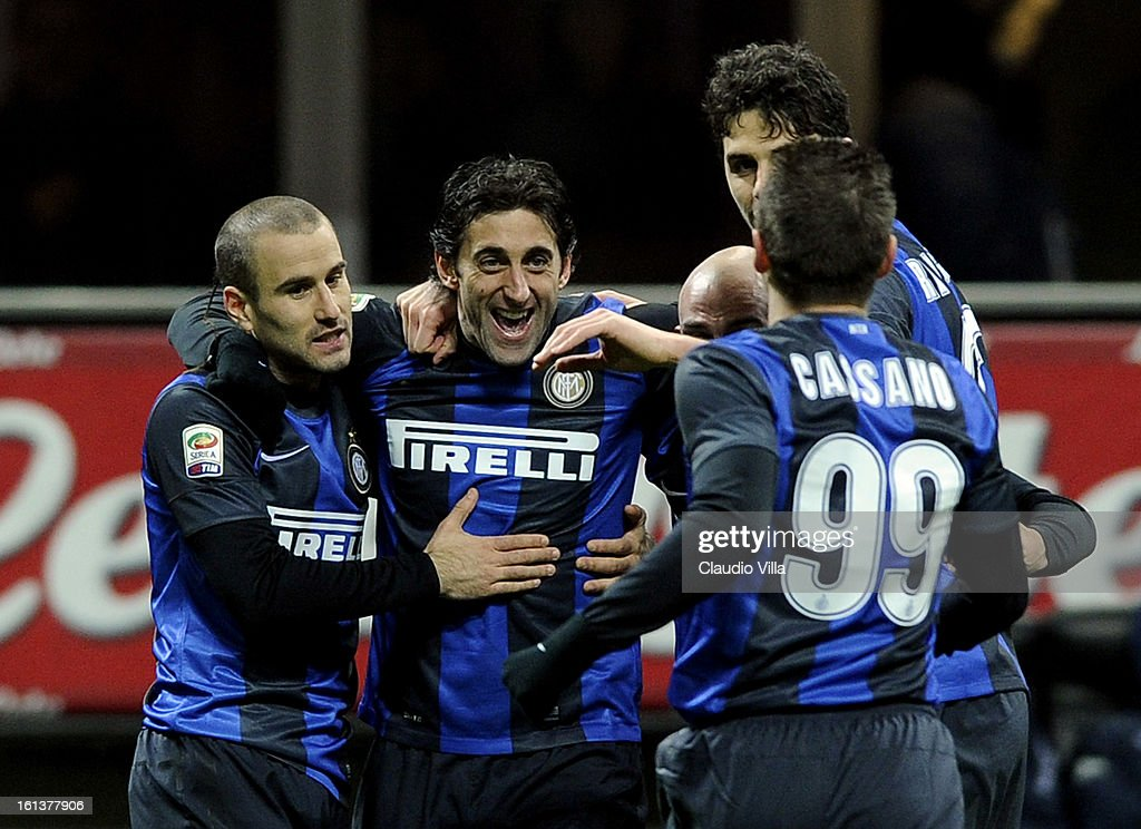Diego Milito of FC Inter (2nd L) celebrates with team-mates after scoring the third goal during the Serie A match between FC Internazionale Milano and AC Chievo Verona at San Siro Stadium on February 10, 2013 in Milan, Italy.