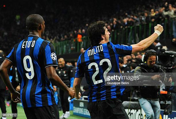 Diego Milito of Inter celebrates with team mate Samuel Eto'o after scoring the opening goal during the UEFA Champions League Quarter Finals, First...