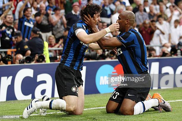 Diego Milito of Inter Milan celebrates with team mate Maicon after scoring the opening goal during the UEFA Champions League Final match between FC...