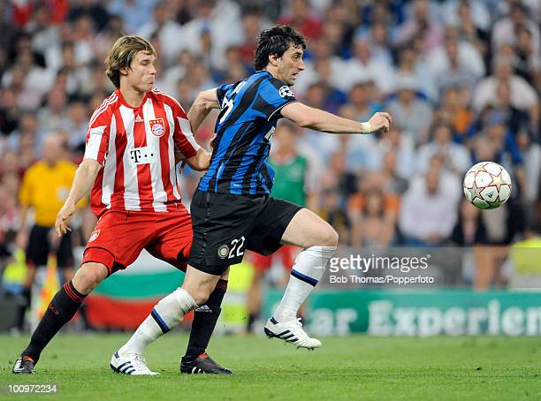 Diego Milito of Inter Milan moves away from Holger Badstuber of Bayern Munich during the UEFA Champions League Final match between Bayern Munich and...
