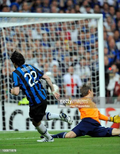 Diego Milito of Inter Milan scores the second of his two goals during the UEFA Champions League Final match between Bayern Munich and Inter Milan at...