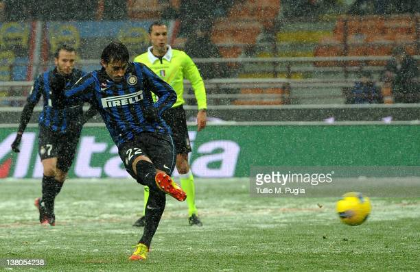 Diego Milito of Inter scores the penalty during the Serie A match between FC Internazionale Milano and US Citta di Palermo at Stadio Giuseppe Meazza...
