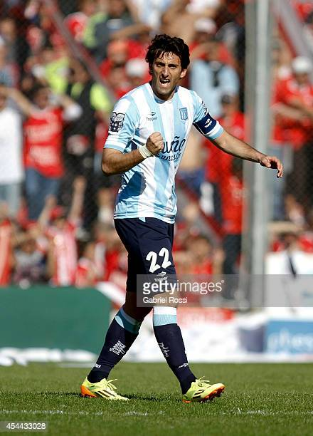 Diego Milito of Racing Club celebrates after scoring the opening goal against Independiente during a match between Independiente and Racing as part...