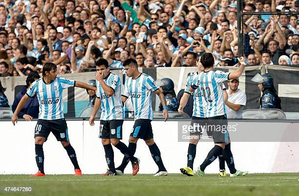 Diego Milito of Racing Club celebrates with his teammates after scoring the first goal of his team from the penalty spot during a match between...