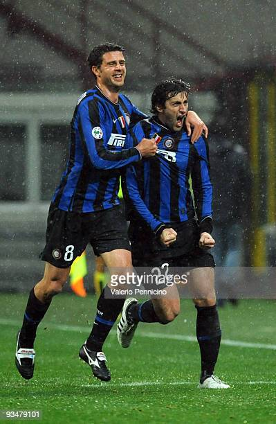 Diego Milito with Thiago Motta of FC Internazionale celebrate his goal during the Serie A match between Inter Milan and Fiorentina at Stadio Giuseppe...