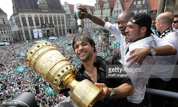 Diego Naldo and Hugo Almeida celebrate with the DFB Cup trophy on the balcony of Bremen's town hall on May 31 2009 in Bremen Germany