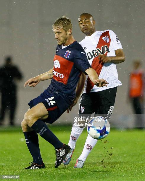Diego Nicolas De la Cruz of River Plate fights for the ball with Maximiliano Caire of Tigre during a match between Tigre and River Plate as part of...