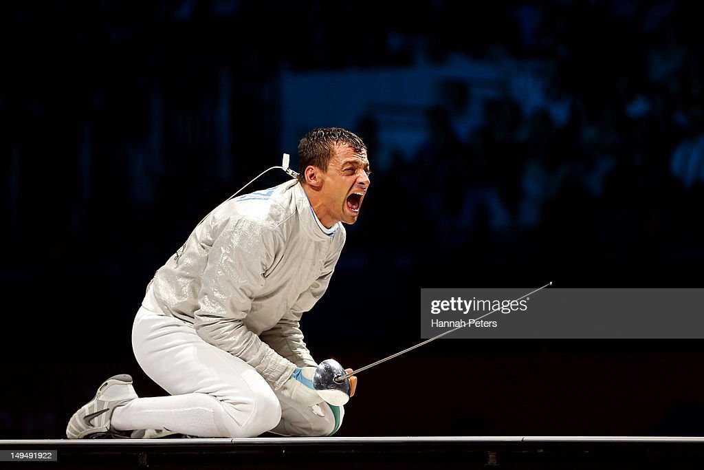 Diego Occhiuzzi (R) of Italy reacts while competing against Rares Dumitrescu of Romania during their Men's Sabre Individual semifinal match on Day 2 of the London 2012 Olympic Games at ExCeL on July 29, 2012 in London, England.