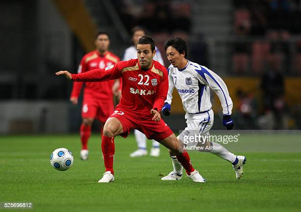 Diego of Adelaide United and Hideo Hashimoto of Gamba Osaka