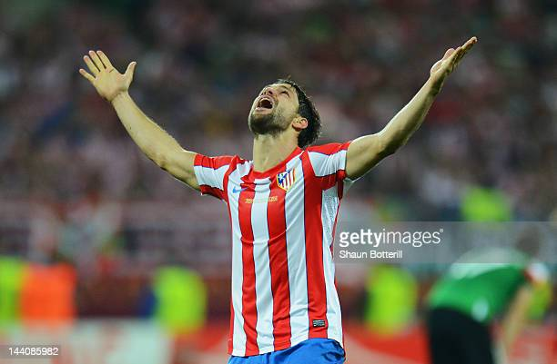 Diego of Atletico Madrid celebrates scoring his team's third goal during the UEFA Europa League Final between Atletico Madrid and Athletic Bilbao at...