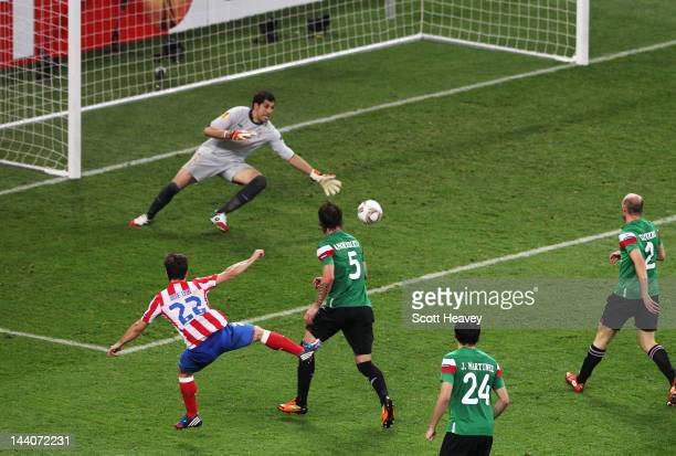 Diego of Atletico Madrid scores his team's third goal during the UEFA Europa League Final between Atletico Madrid and Athletic Bilbao at the National...