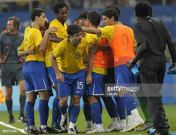 Diego of Brazil is congratulated by his teammates after scoring a goal against Belgium during the 2008 Beijing Olympic Games men's football bronze...