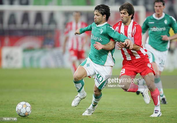 Diego of Bremen and Konstantinos Mendrinos of Piraeus fight for the ball during the UEFA Champions League Group C match between Olympiakos and Werder...