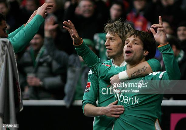 Diego of Bremen celebrates scoring the first goal with Aaron Hunt during the Bundesliga match between Bayern Munich and Werder Bremen at the Allianz...