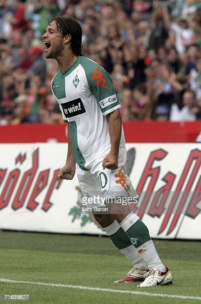 Diego of Bremen celebrates scoring the first goal with team mates during the Bundesliga match between Hanover 96 and Werder Bremen at the AWD Arena...