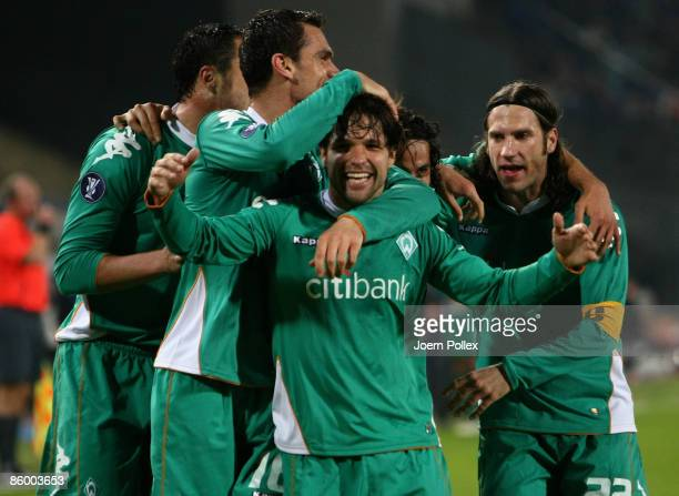 Diego of Bremen celebrates with his team mates after scoring his team's second goal during the UEFA Cup quarter final second leg match between...