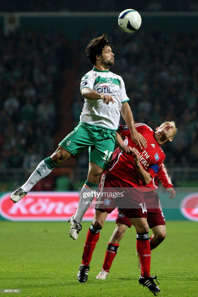 Diego of Bremen goes up for a header with David Jarolim of Hamburg during the UEFA Cup Semi Final first leg match between SV Werder Bremen and Hamburger SV at the Weser stadium on April 30, 2009 in Bremen, Germany.