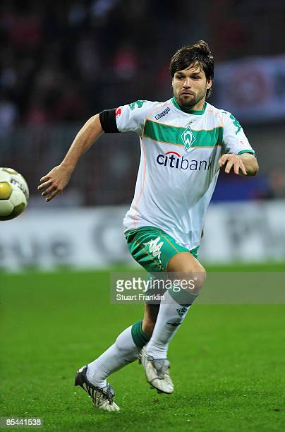 Diego of Bremen runs with the ball during the Bundesliga match between Werder Bremen and VfB Stuttgart at the Weser Stadium on March 15, 2009 in...