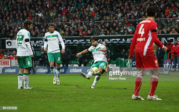 Diego of Bremen scores the first goal for his team during the Bundesliga match between Werder Bremen and VfB Stuttgart at the Weser stadium on March...