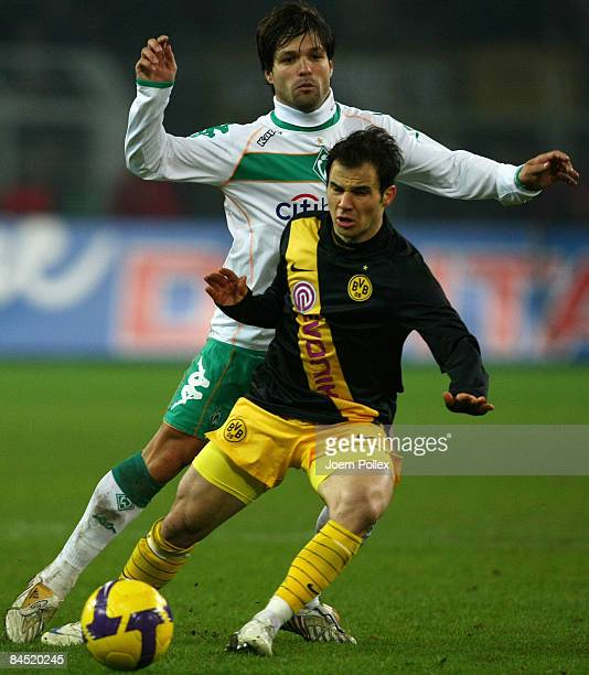 Diego of Bremen tackles Tamas Hajnal of Dortmund during the round of 16 DFB Cup match between Borussia Dortmund and SV Werder Bremen on January 28...