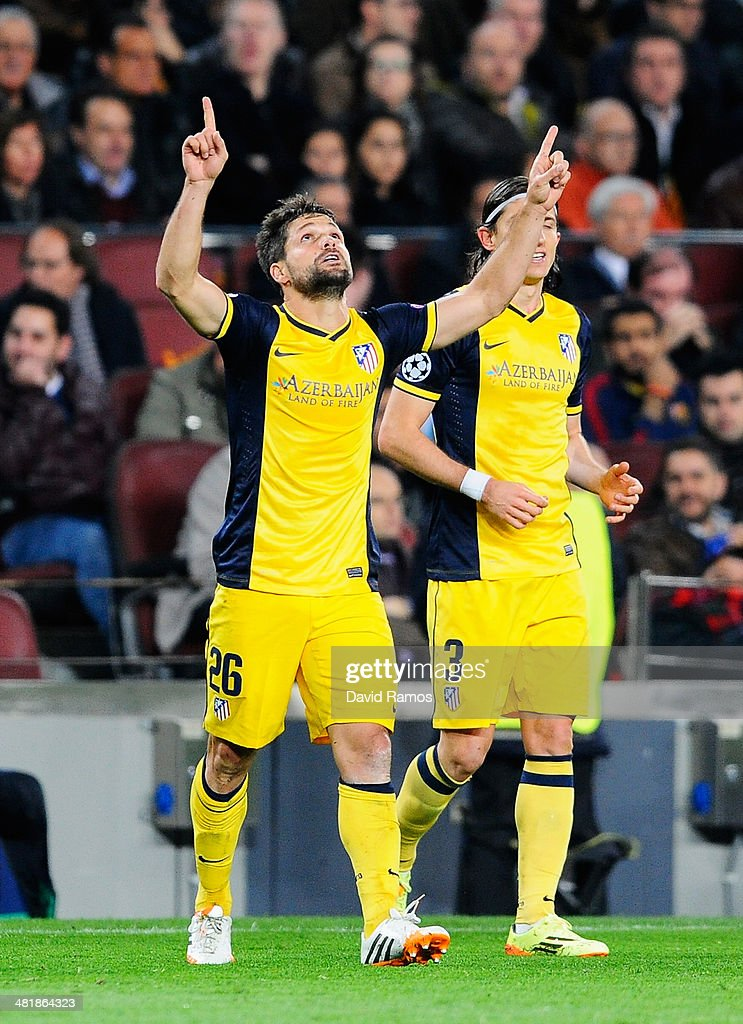 Diego of Club Atletico de Madrid celebrates scoring the opening goal during the UEFA Champions League Quarter Final first leg match between FC Barcelona and Club Atletico de Madrid at Camp Nou on April 1, 2014 in Barcelona, Spain.
