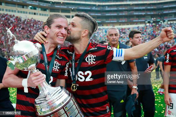 Diego of Flamengo kisses his teammate Filipe Luis after the final match of Copa CONMEBOL Libertadores 2019 between Flamengo and River Plate at...