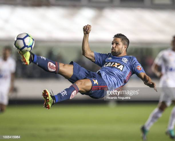 Diego of Flamengo on the ball during a match between Santos and Flamengo as a part of Campeonato Brasileiro 2018 at Vila Belmiro Stadium on July 25...