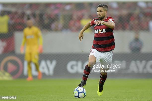 Diego of Flamengo runs with the ball during the match between Flamengo and Corinthians as part of Brasileirao Series A 2018 at Maracana Stadium on...