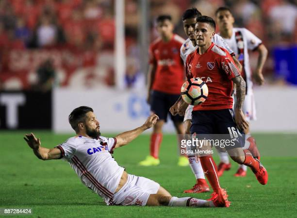 Diego of Flamengo struggles for the ball with Fabricio Bustos of Independiente during the first leg of the Copa Sudamericana 2017 final between...