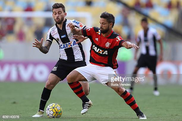 Diego of Flamengo struggles for the ball with Lucas Lima of Santos during a match between Flamengo and Santos as part of Brasileirao Series A 2016 at...