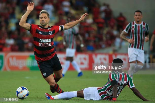 Diego of Flamengo struggles for the ball with Marcos Calazans of Fluminense during a match between Flamengo and Fluminense as part of State...