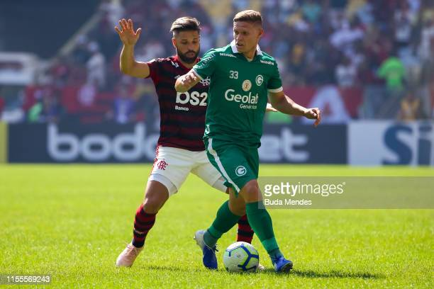 Diego of Flamengo struggles for the ball with Marlone of Goias during a match between Flamengo and Goias as part of Brasileirao Series A 2019 at...