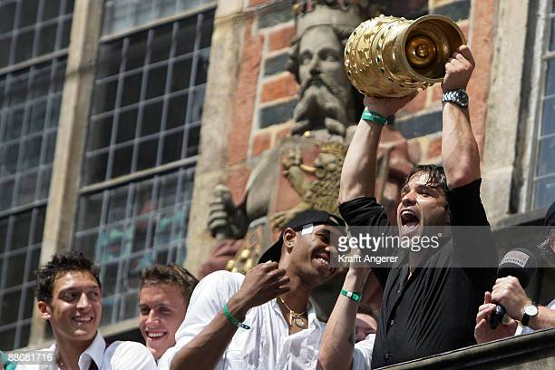 Diego of Werder Bremen raises the DFP Cup trophy on the balcony of Bremen's town hall on May 31 2009 in Bremen Germany