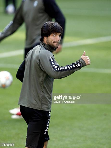 Diego of Werder Bremen waves to press during a training session before the match between Real Madrid and Werder Bremen at the Santiago Bernabeu...