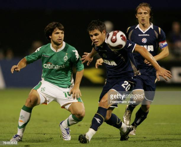 Diego of Werder fights for the ball with Ognjen Vukojevic and Luka Modric of Zagreb during the Champions League third qualifying round second leg...