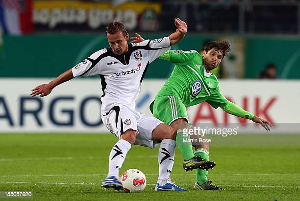 Diego of Wolfsburg and Manuel Konrad of Frankfurt battle for the ball during the DFB Cup second round match between VfL Wolfsburg and FSV Frankfurt...