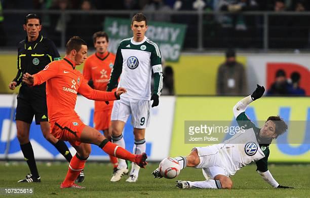 Diego of Wolfsburg and Marko Arnautovic of Bremen battle for the ball during the Bundesliga match between VfL Wolfsburg and SV Werder Bremen at...