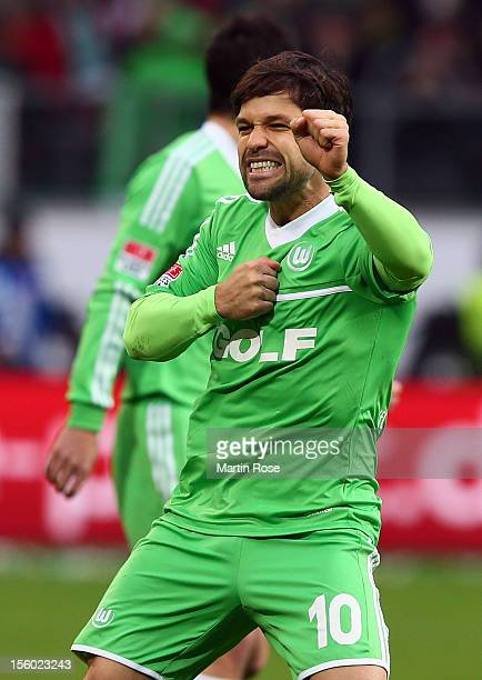 Diego of Wolfsburg celebratea after he scores his team's opening goal during the Bundesliga match between VfL Wolfsburg and Bayer 04 Leverkusen at...