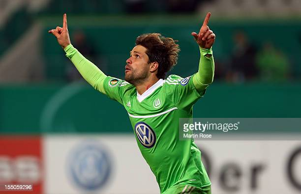 Diego of Wolfsburg celebrates after vhe scores his team's 1st goal during the DFB Cup second round match between VfL Wolfsburg and FSV Frankfurt at...