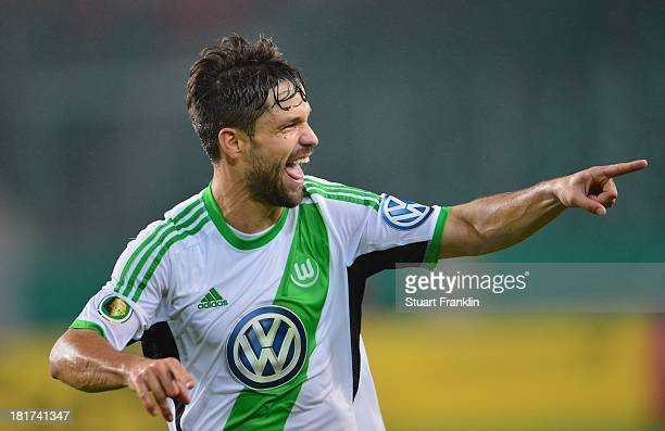 Diego of Wolfsburg celebrates scoring his goal during the second round DFB cup match between VfL Wolfsburg and Vfr Aalen at Volkswagen Arena on...
