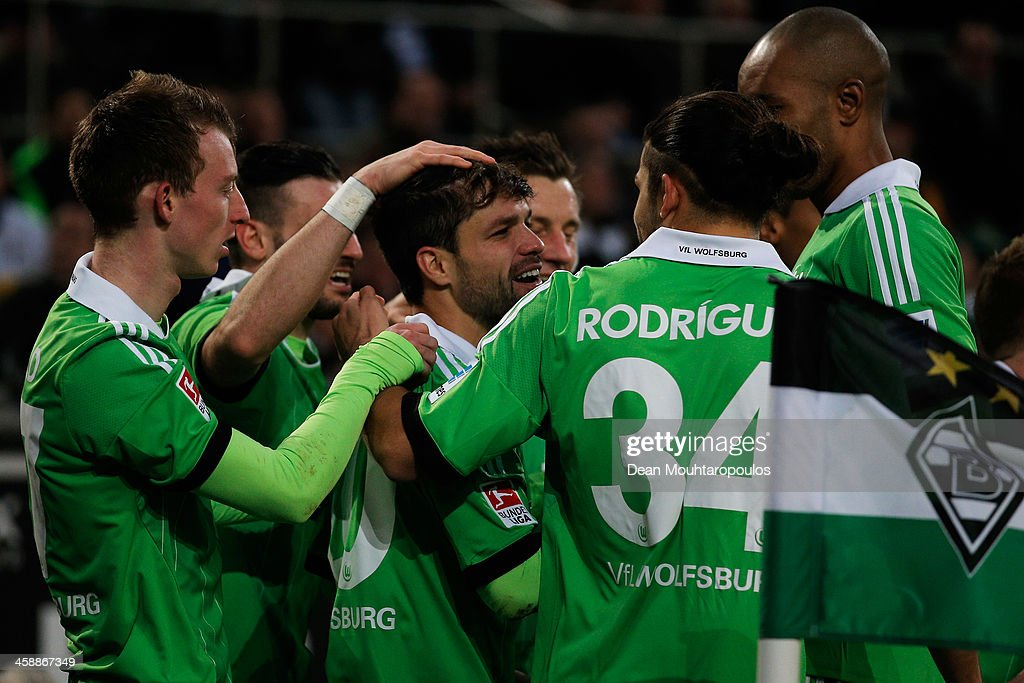 Diego (C) of Wolfsburg celebrates with team mates after scoring a goal during the Bundesliga match between Borussia Moenchengladbach and VfL Wolfsburg held at Borussia-Park on December 22, 2013 in Moenchengladbach, Germany.