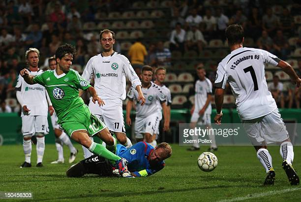 Diego of Wolfsburg scores his team's third goal for the ball during the DFB Cup first round match between SV FC Schoenberg 95 and VfL Wolfsburg at...
